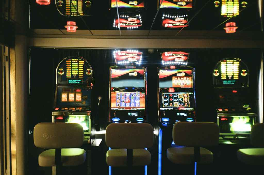 row of electronic slot machines inside a casino