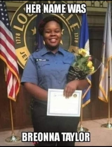 "Image: Breonna Taylor in her EMT uniform at graduation. Text: ""Her name was Breonna Taylor."""